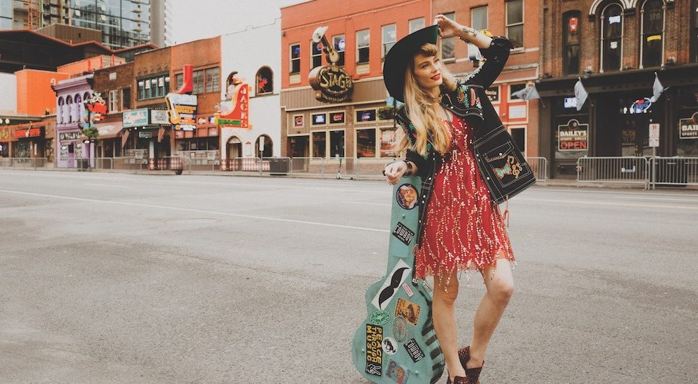 model standing on broadway street in nashville